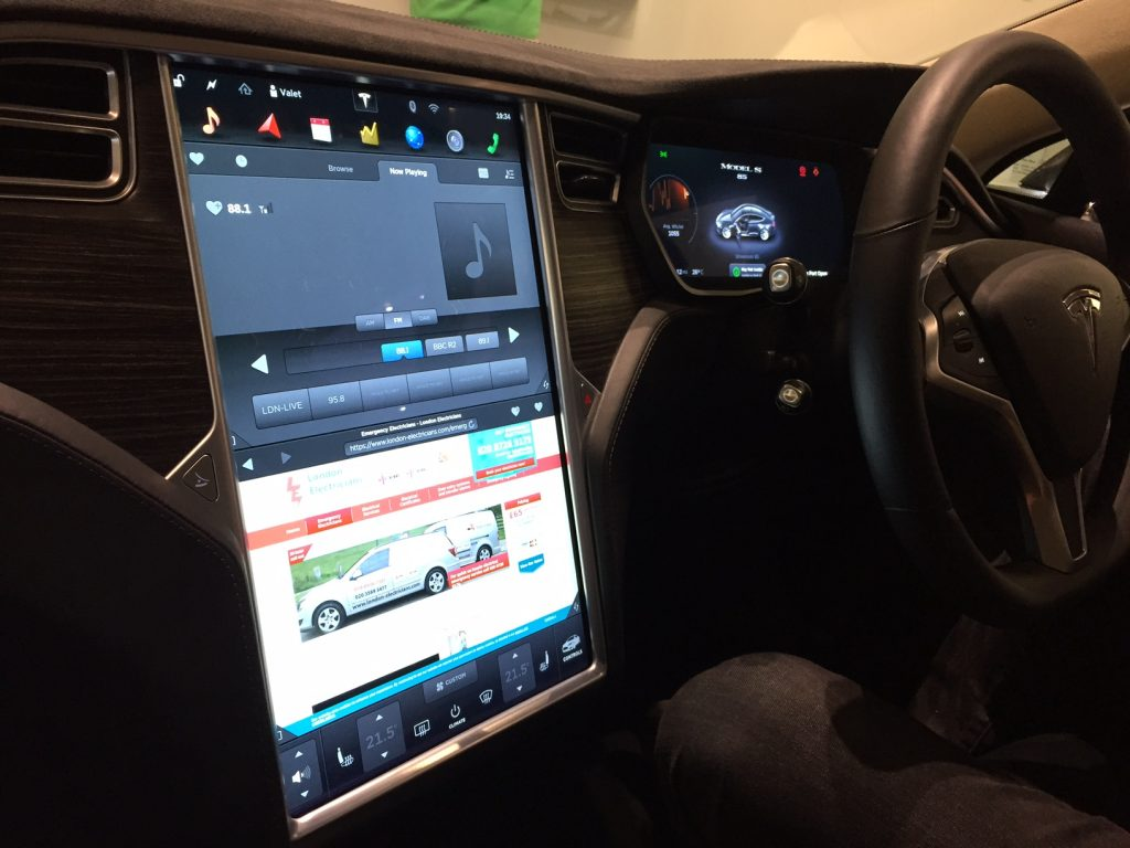 A picture showing the touchscreen dashboard of a Tesla that is on the London Electricians website