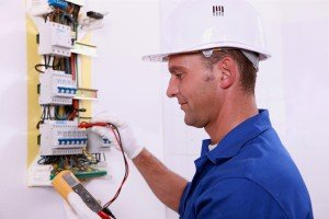 A picture of someone carrying out electrical testing at a residential property