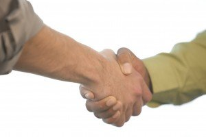 A picture of an electrical contractor shaking hands with someone