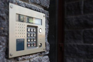 An image of an access control system on the outside wall of a house