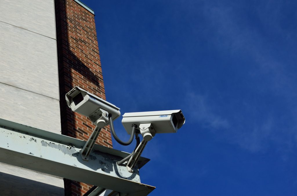 A close up of two CCTV cameras, part of an electrical installation in London