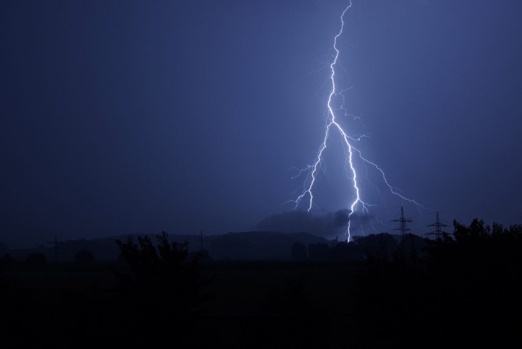 A picture showing a sky during a storm with lightning that has caused an electrical power cut