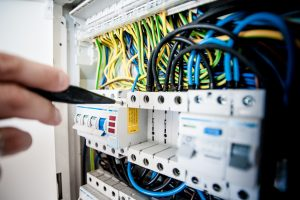 A picture of a worker carrying out an electrical installation