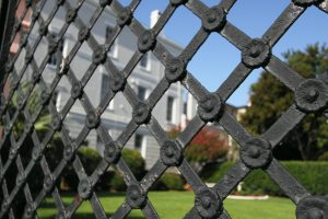 Section of fence linked to electric gates