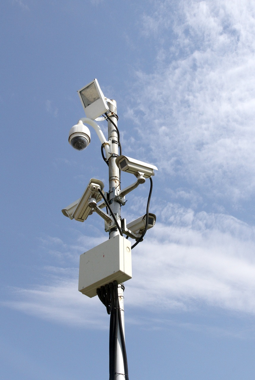 A picture of two office CCTV cameras