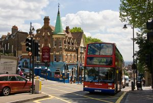 An image of a bus travelling through Haringey, one of the London areas serviced by London Electricians
