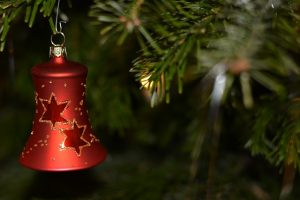 Image of a baubel hanging from a Christmas tree
