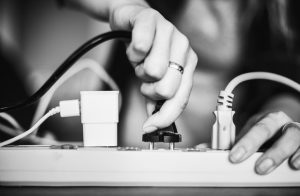 An image of someone plugging a socket into an extension cable