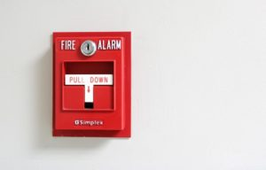 An image of fire alarm secured to a wall.