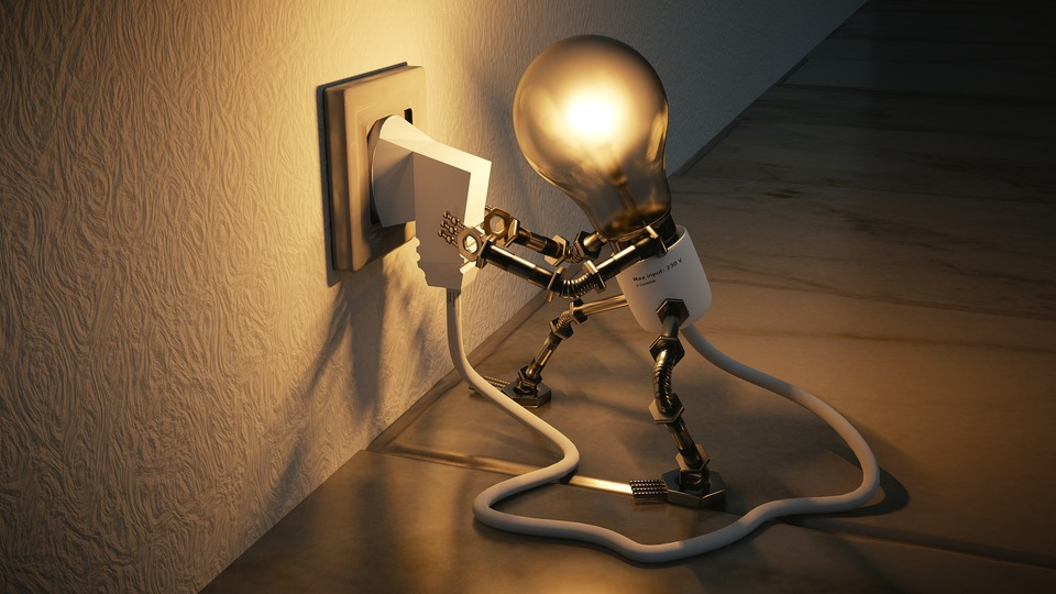 An image of a plug socket, providing electricity to a light bulb.